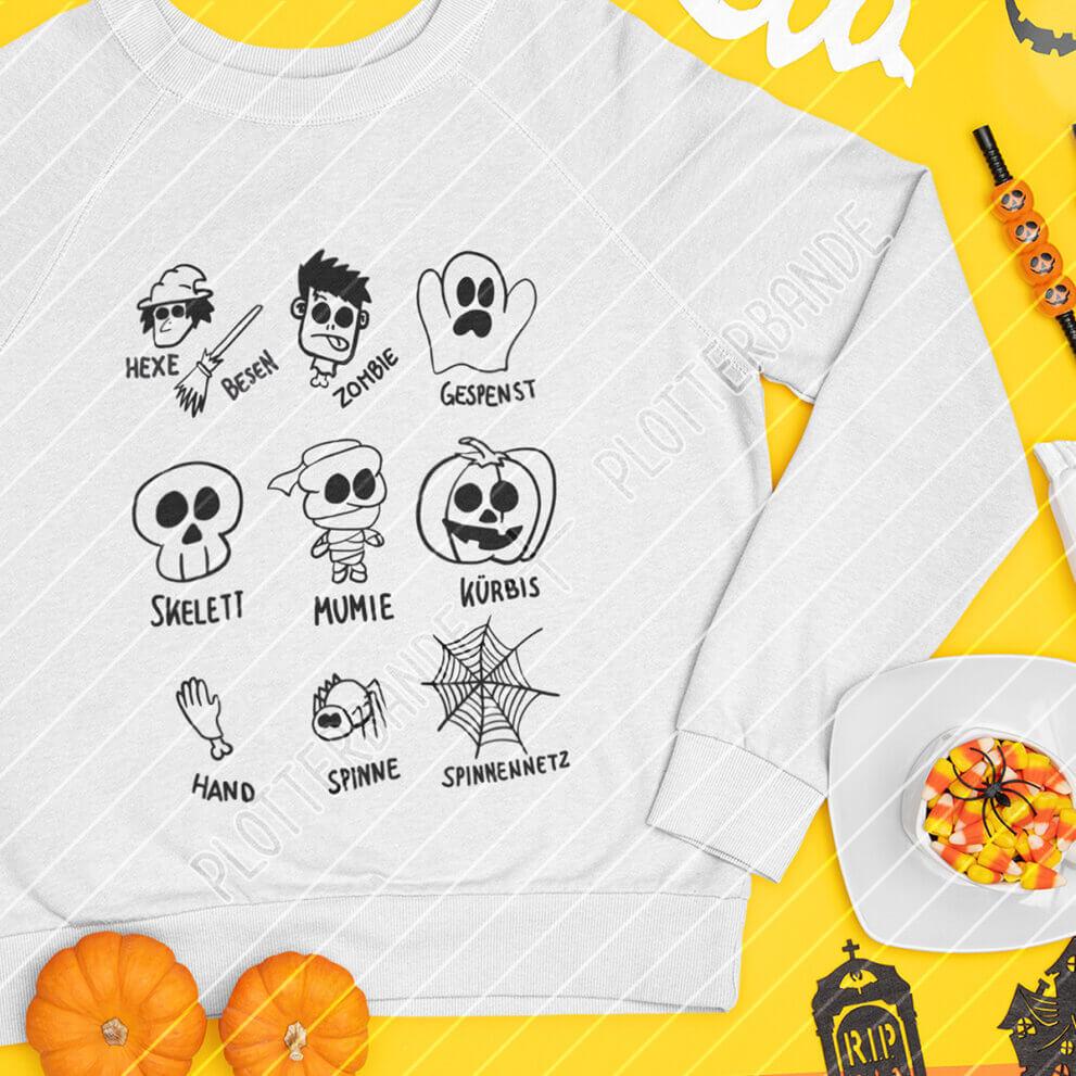 Das Bild zeigt einen weißen Pullover mit der Halloween-Gruselsammlung der Plotterbande.