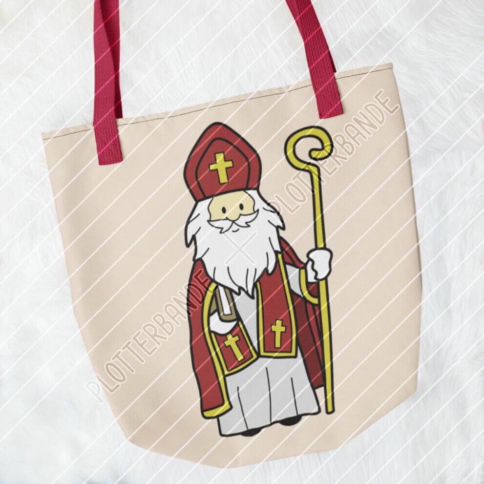 Das Bild zeigt eine Tasche mit dem Heiliger-Nikolaus-Design der Plotterbande.