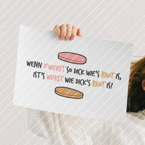 Eine Hand hält ein Plakat mit dem Wurstbrot-Design der Plotterbande in die Kamera.