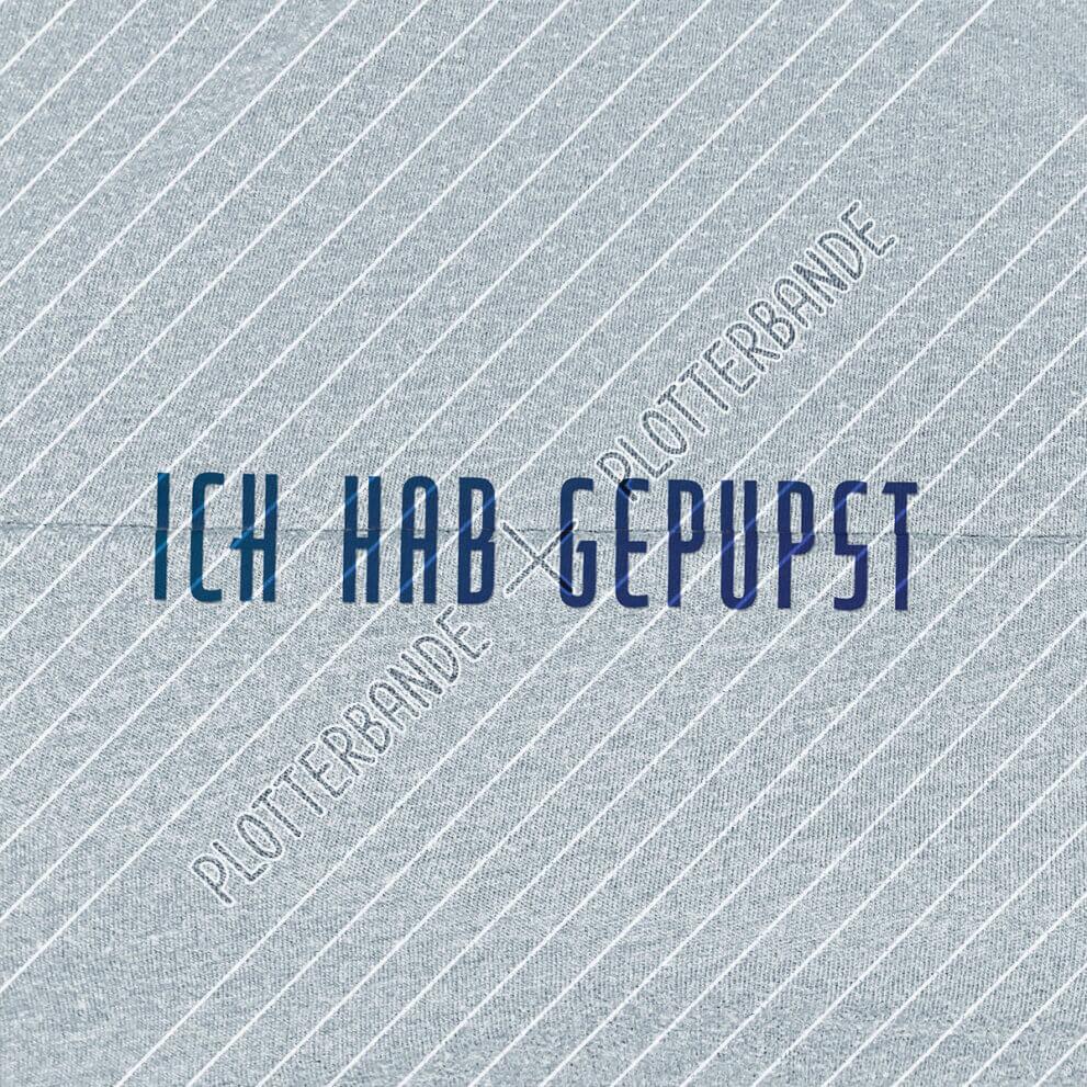 (1) Das Bild zeigt einen blauen Stoff mit dem Geheimschrift-Ich-hab-gepupst-Design der Plotterbande.